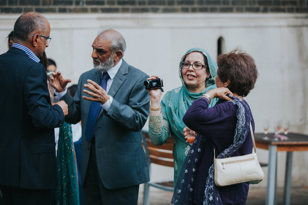 133-Anglo-Asian-London-Wedding-Middle-temple-guest-green-sari-camera.jpg