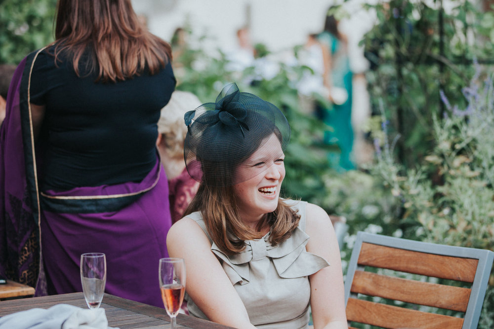 140-London-Wedding-Middle-temple-guest-garden-laughing.jpg