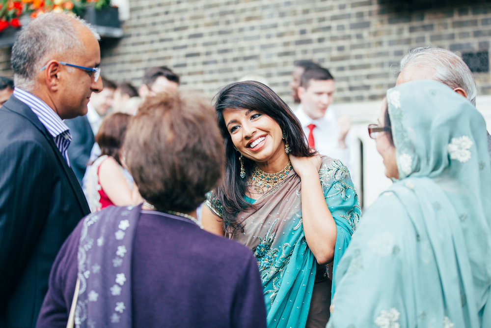 139-Anglo-Asian-London-Wedding-happy-guest-green-sari.jpg