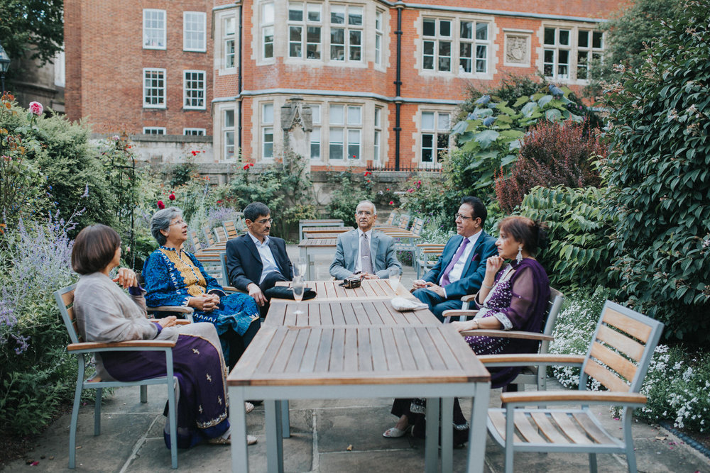 141-London-Wedding-Middle-temple-family-around-table.jpg