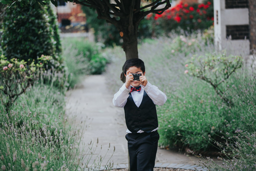 146-London-Wedding-Middle-temple-kid-bowtie-camera.jpg