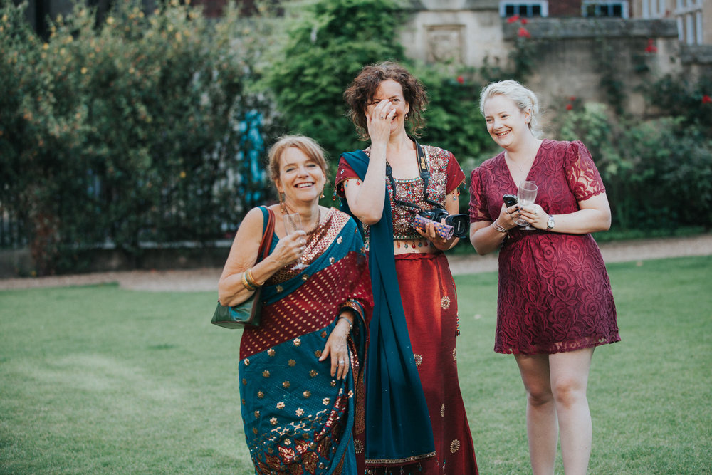 157-Wedding-Middle-temple-guests-laughing-lawn.jpg