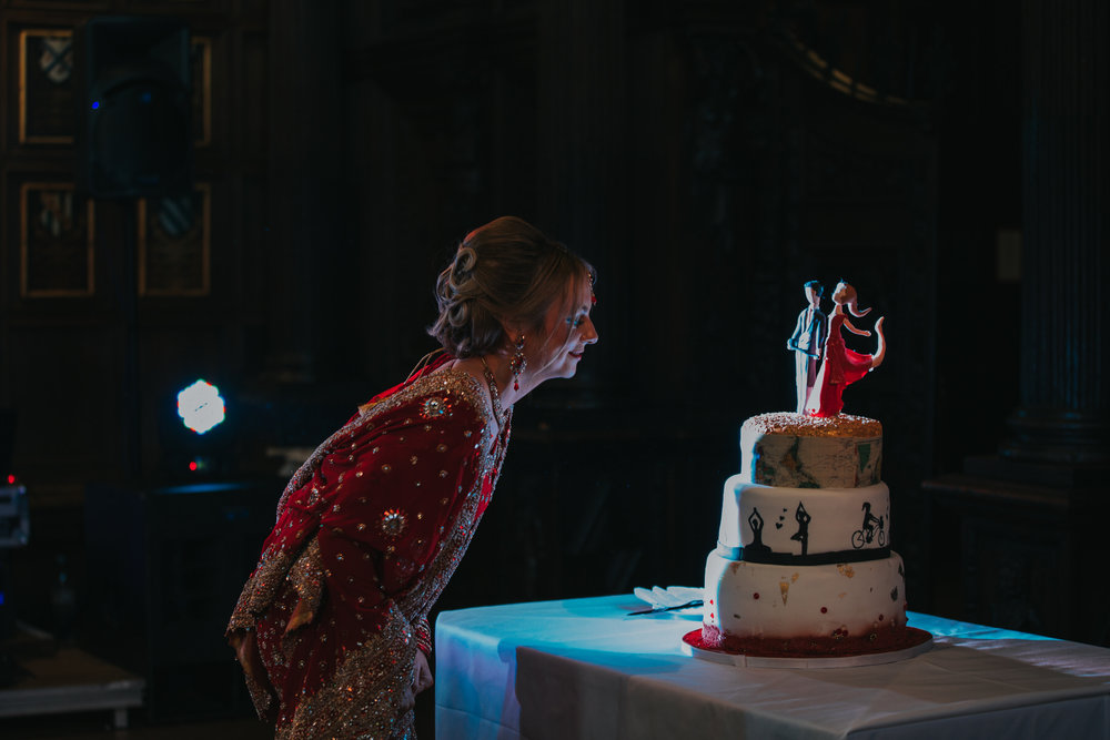 191-bride-looking-unique-wedding-cake-dark.jpg