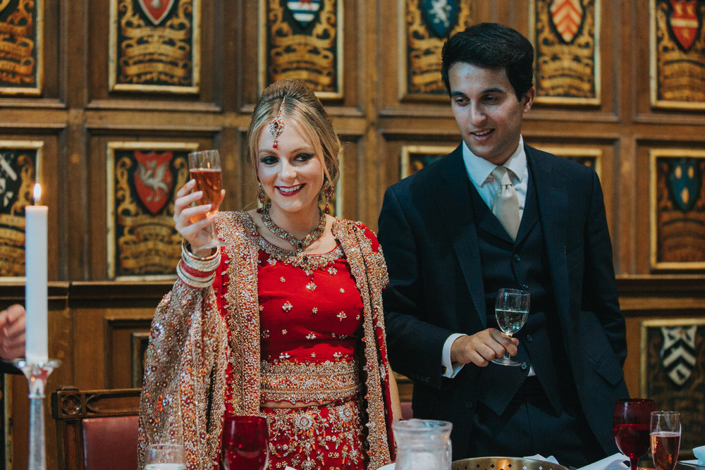 208-Anglo-Asian-London-Wedding-bride-groom-cheers-champagne-cocktails.jpg