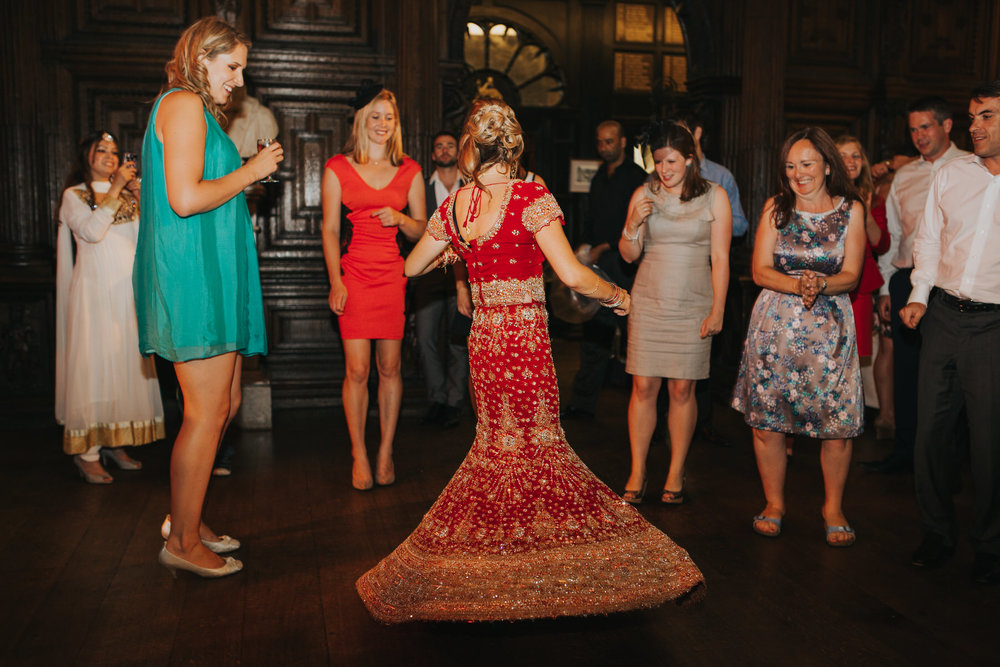 245-Anglo-Asian-London-Wedding-bride-dancing-red-sari.jpg