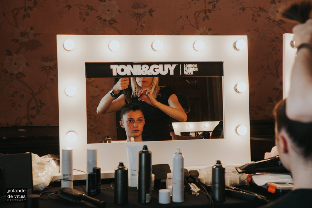 Toni & Guy hair model in mirror backstage fashion