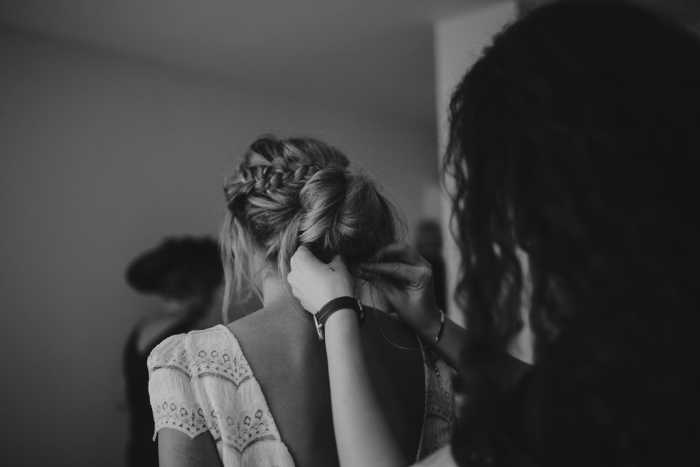 bride final touches to wedding hair during bridal preparations.jpg