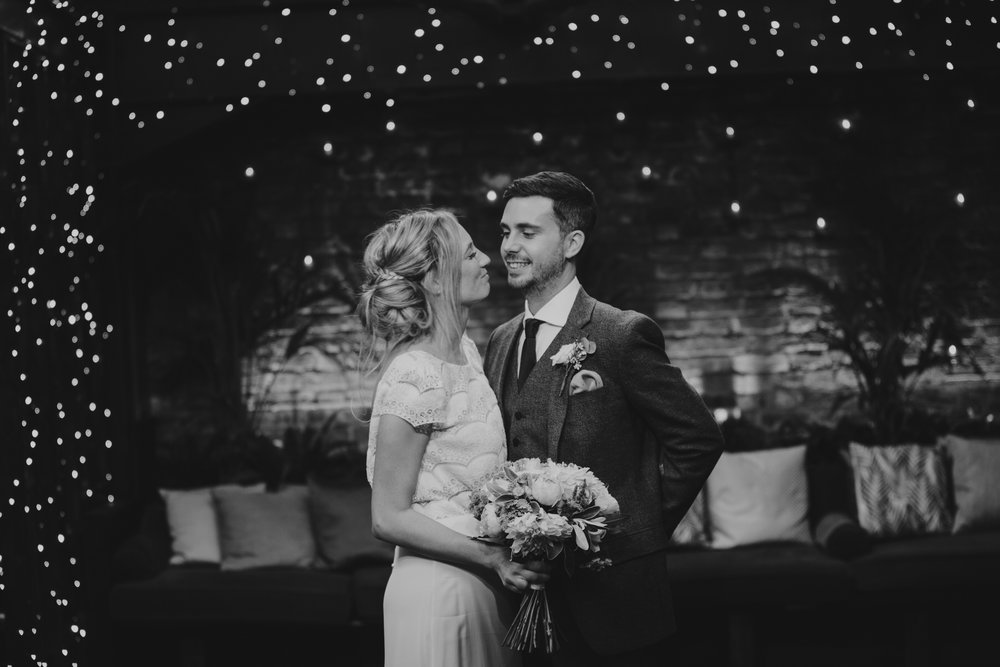 Century Club black and white image bride groom under fairy lights.jpg