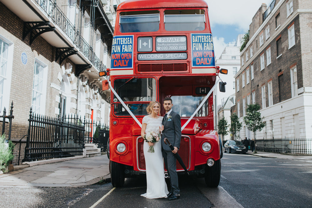 bride groom red wedding bus London street.jpg