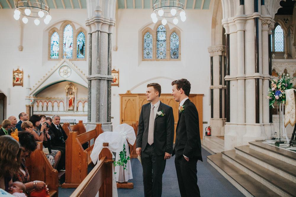 8 groom waiting bestman Fulham Catholic Church wedding.jpg