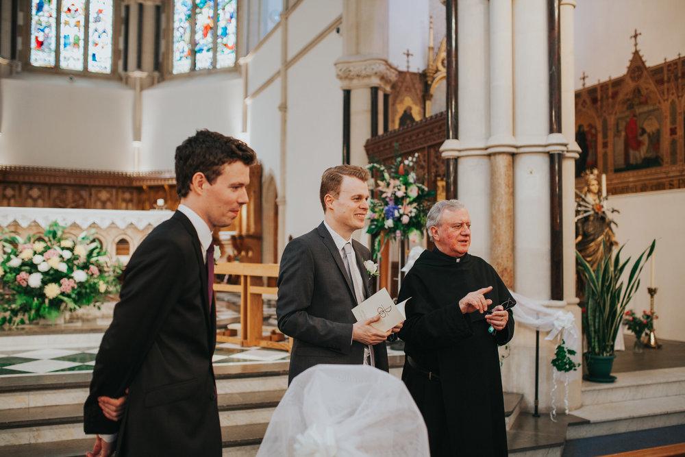 7 groom bestman waiting father Fulham Catholic Church wedding.jpg