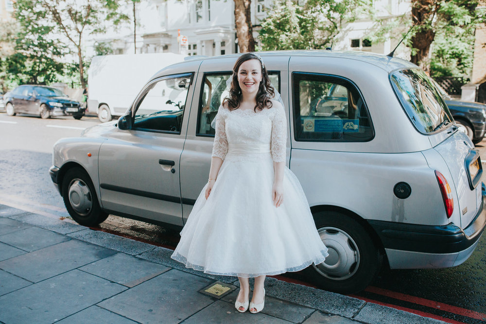 13 bride silver London cab outside Fulham Catholic Church.jpg