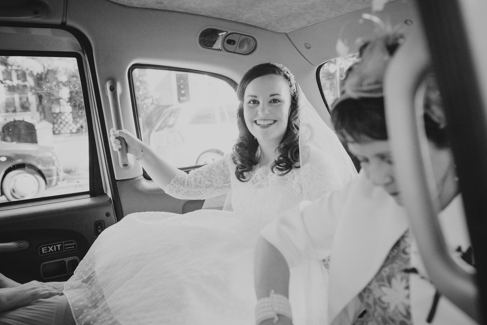 10 bride in London cab arriving Fulham Catholic Church wedding.jpg