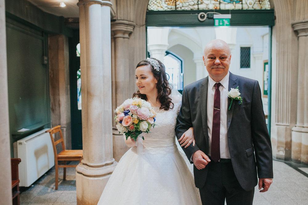 15 father walking bride Fulham Catholic Church wedding.jpg