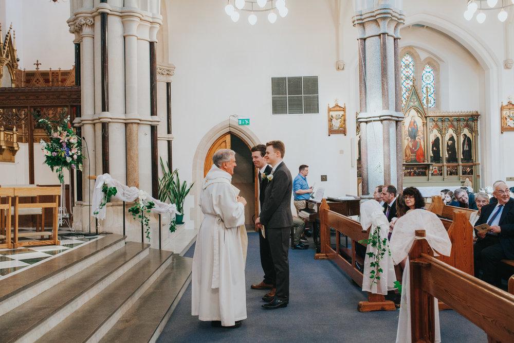 20 groom bestman waiting at altar Fulham Catholic Church wedding.jpg