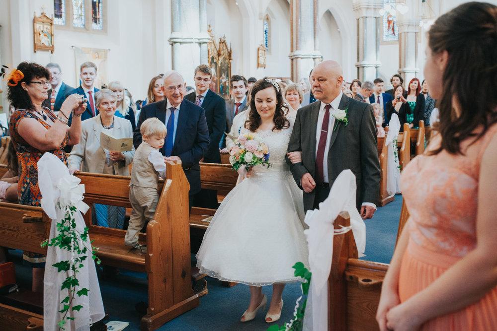 25 bride and dad Fulham Catholic Church wedding.jpg