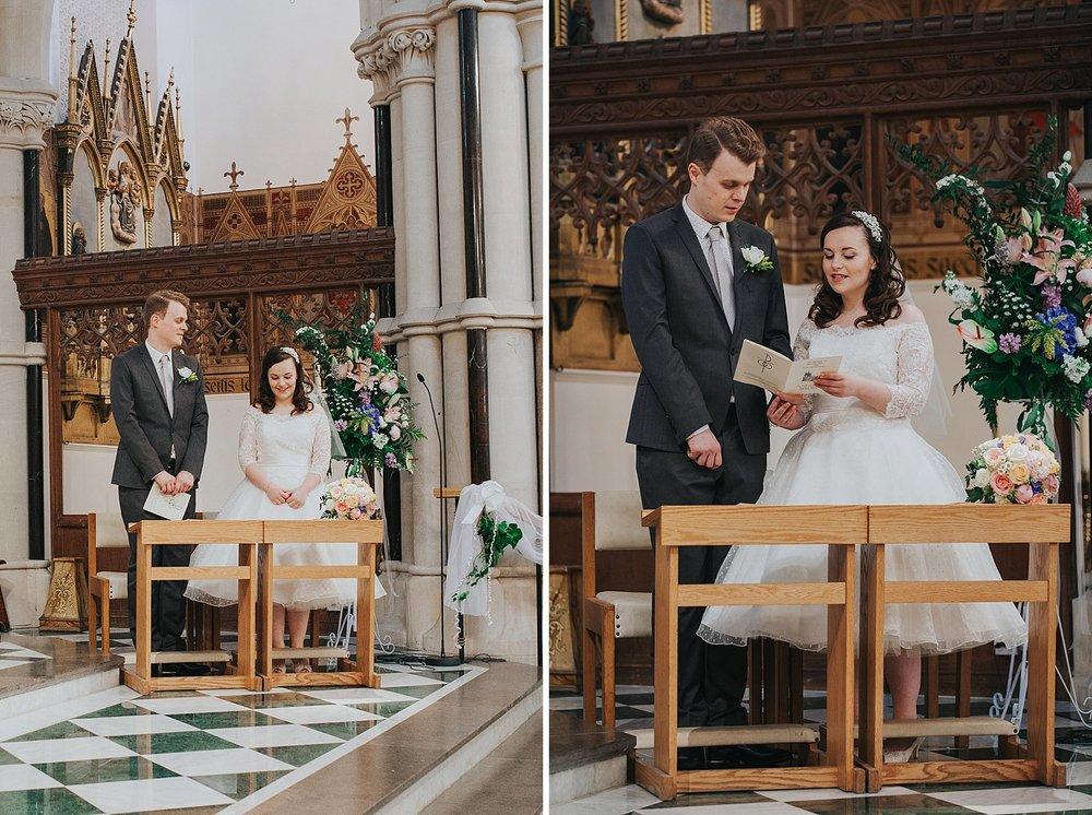 29 groom singing bride Catholic Church wedding ceremony.jpg