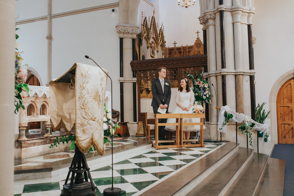 28 bride groom Fulham Catholic Church altar.jpg