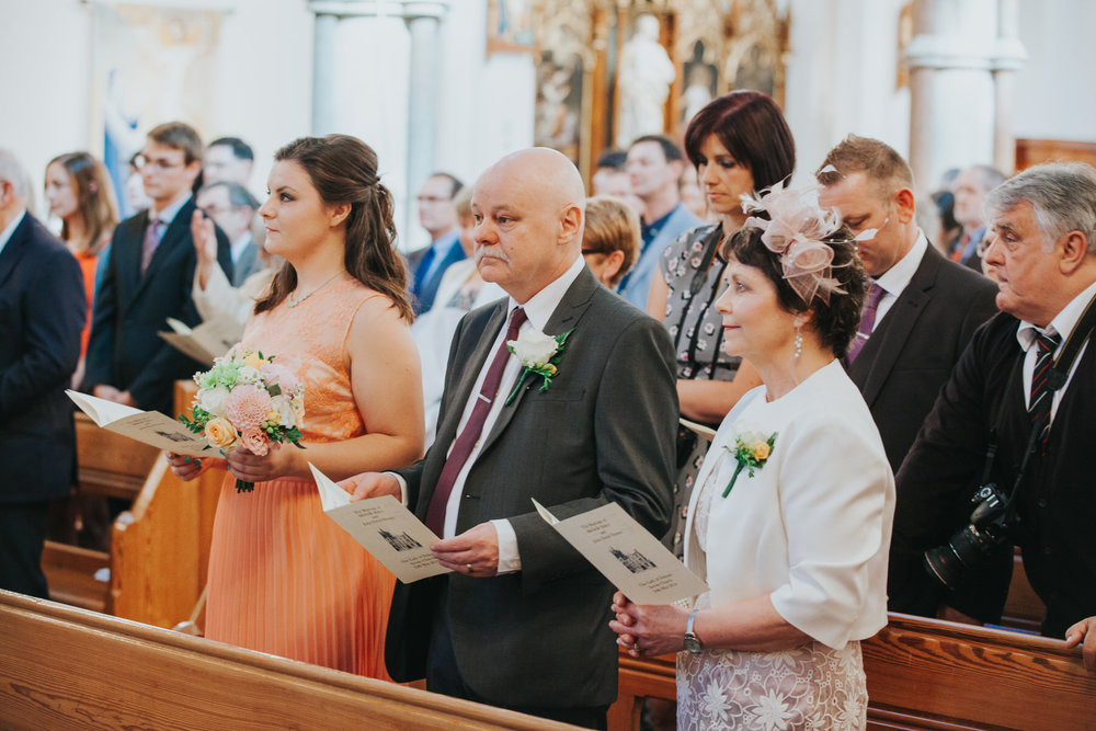 31 brides parents sister singing hymns Church wedding.jpg
