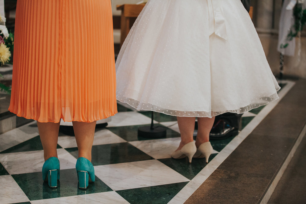 43 bridesmaid bride shoe shot black white tile floor.jpg