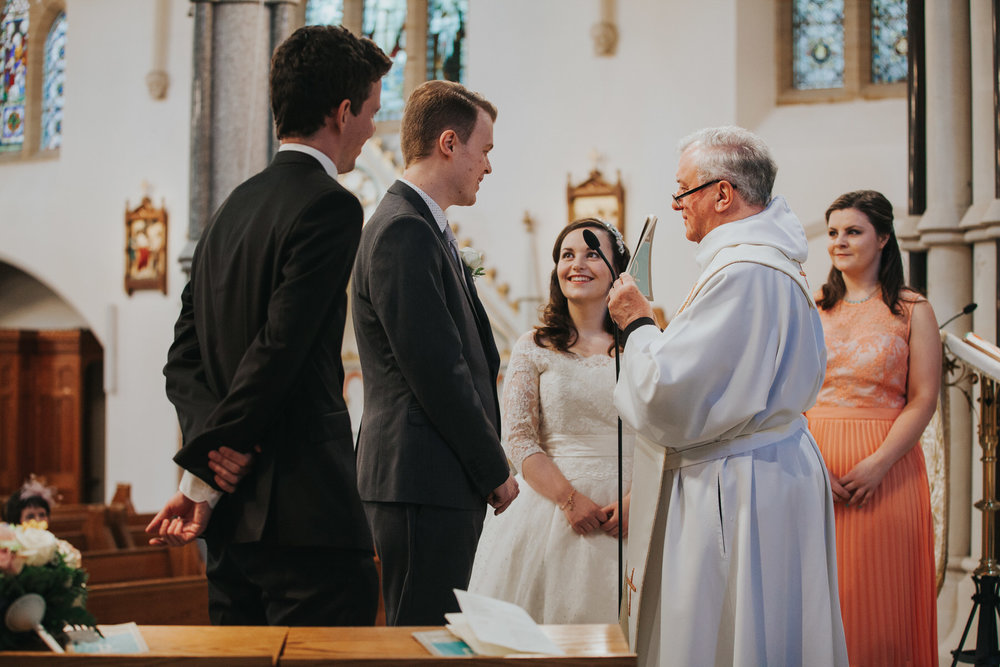 47 couple getting married Catholic Church wedding ceremony.jpg