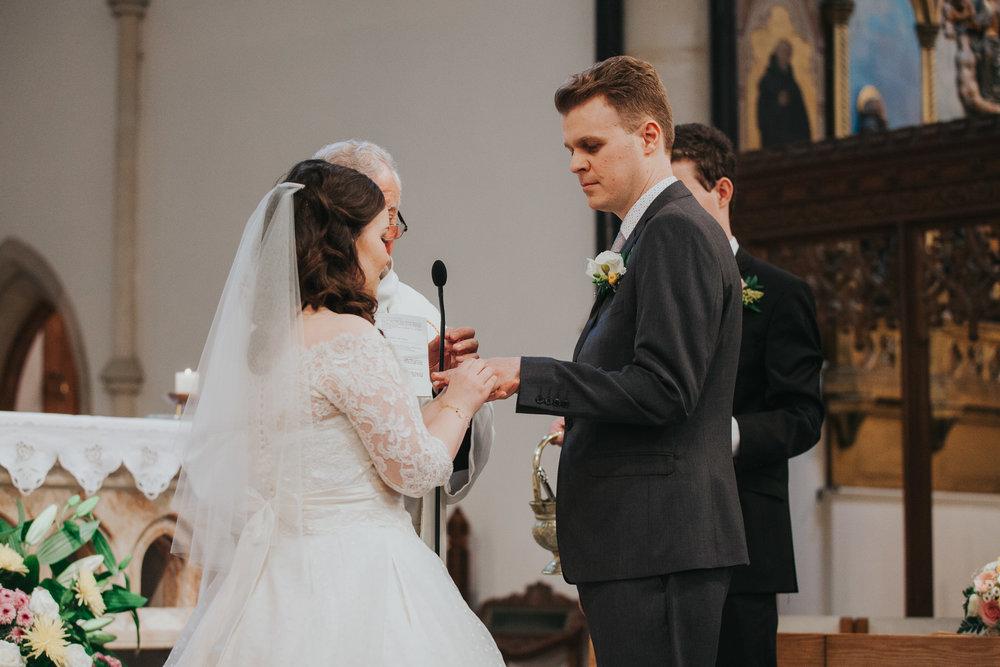 54 exchange of rings during Catholic Church wedding.jpg