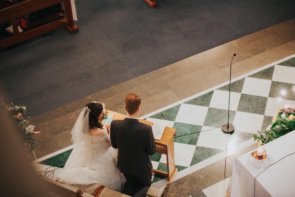 58 view above bride groom Catholic Church wedding.jpg