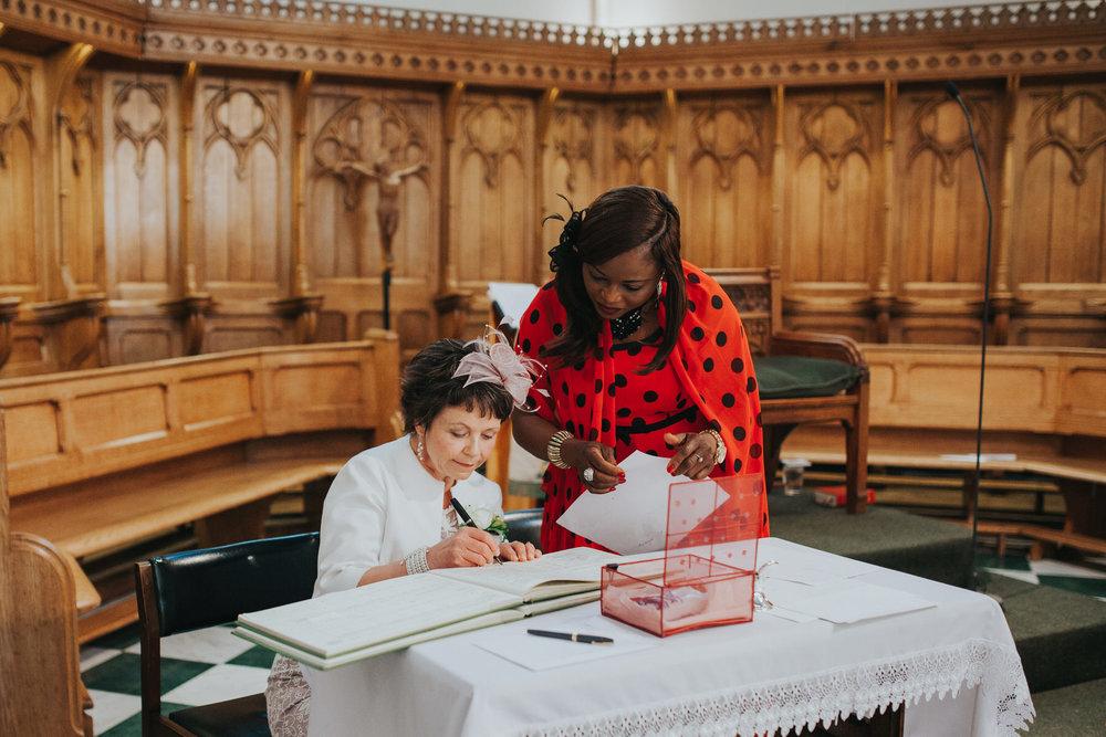64 mother of bride signing register wedding.jpg