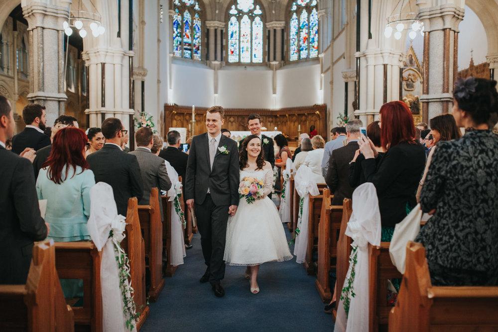 71 bride groom walking down aisle Fulham Catholic Church wedding.jpg