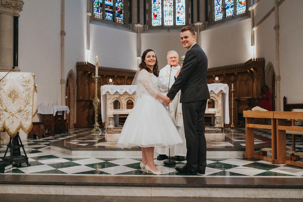 68 newly married couple Catholic Church wedding.jpg