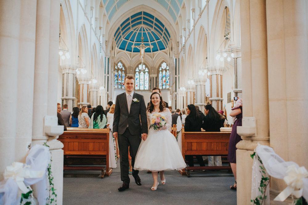 72 newly married couple exit Fulham Catholic Church.jpg