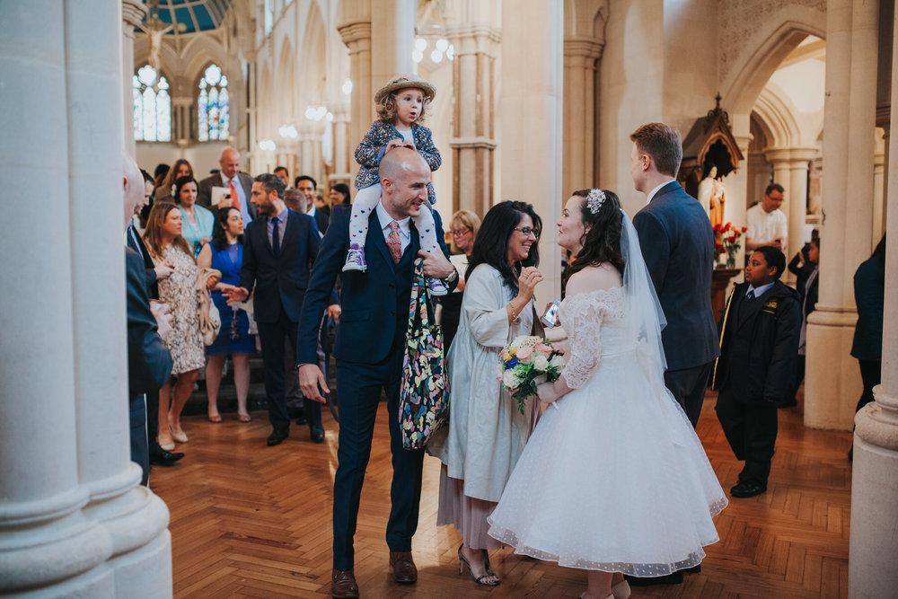 77 receiving line Catholic Church wedding.jpg