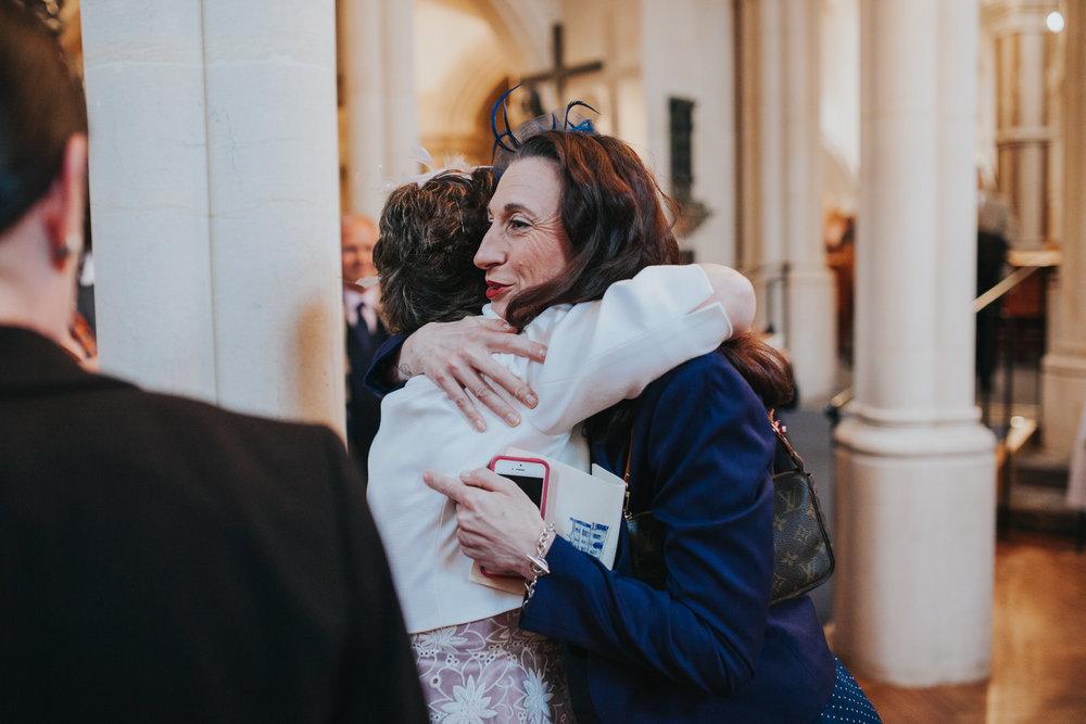 80 happy mother of bride hug guest.jpg