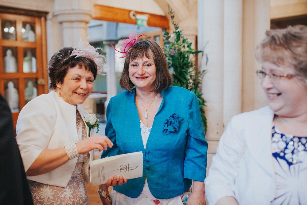 87 beaming mother of bride  Catholic Church wedding.jpg