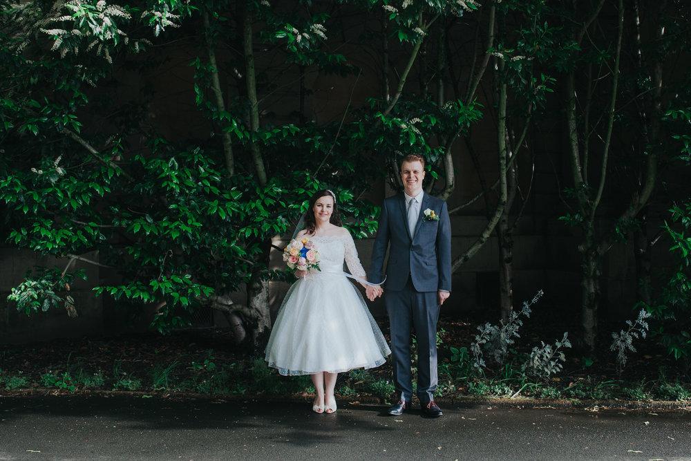 97 groom bride wedding portraits Brompton Cemetery leafy background.jpg