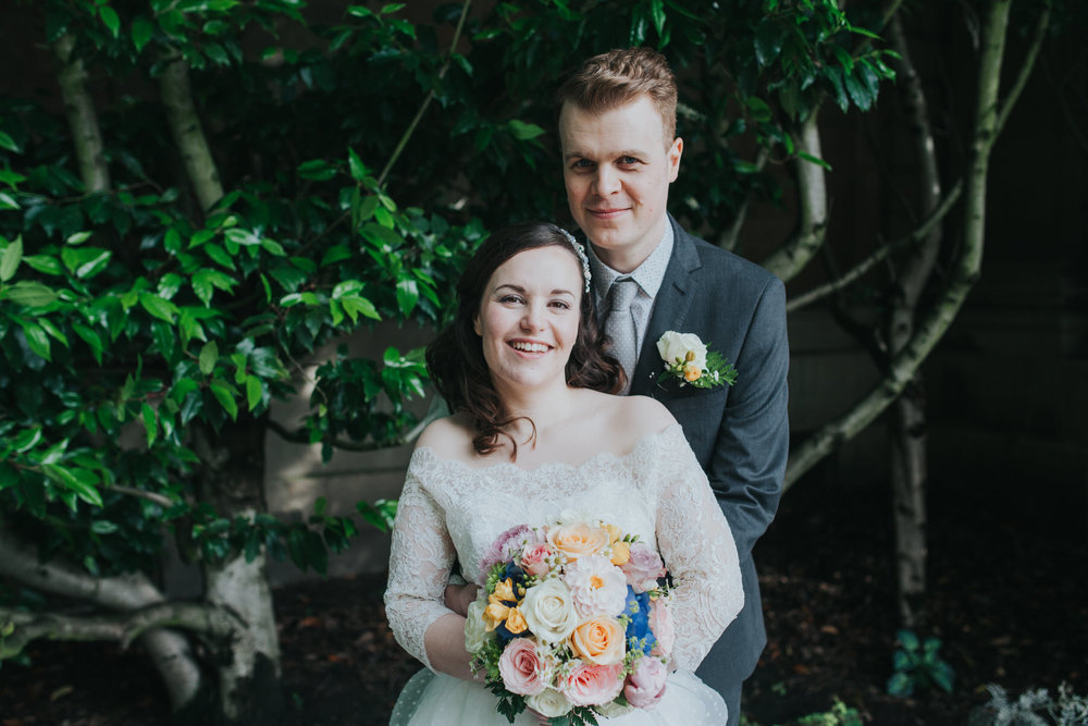 102 groom bride wedding portraits Brompton Cemetery green background.jpg