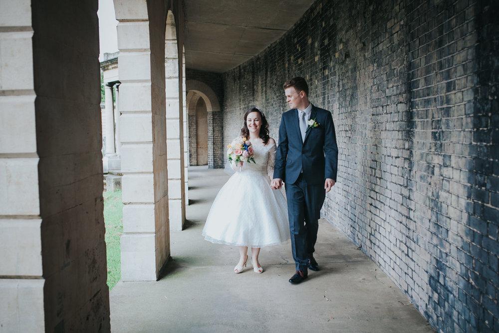 115 groom bride wedding portraits collonade Brompton Cemetery.jpg