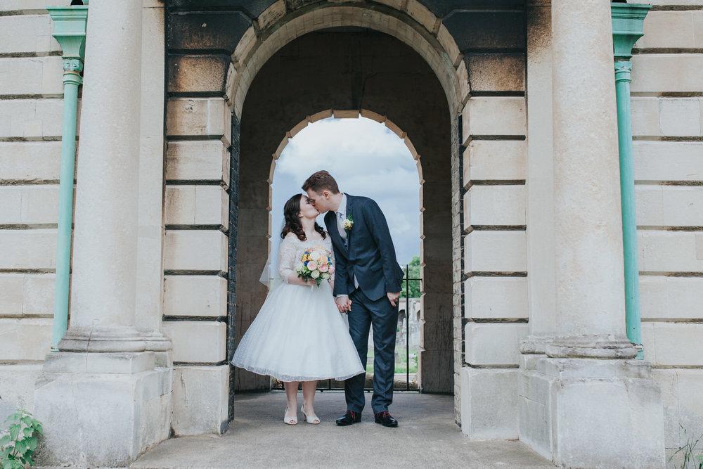 117 groom bride kissing bridal couple portraits Brompton Cemetery.jpg