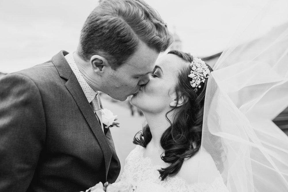 141 groom bride kissing couple portraits windy veil Brompton Cemetery.jpg