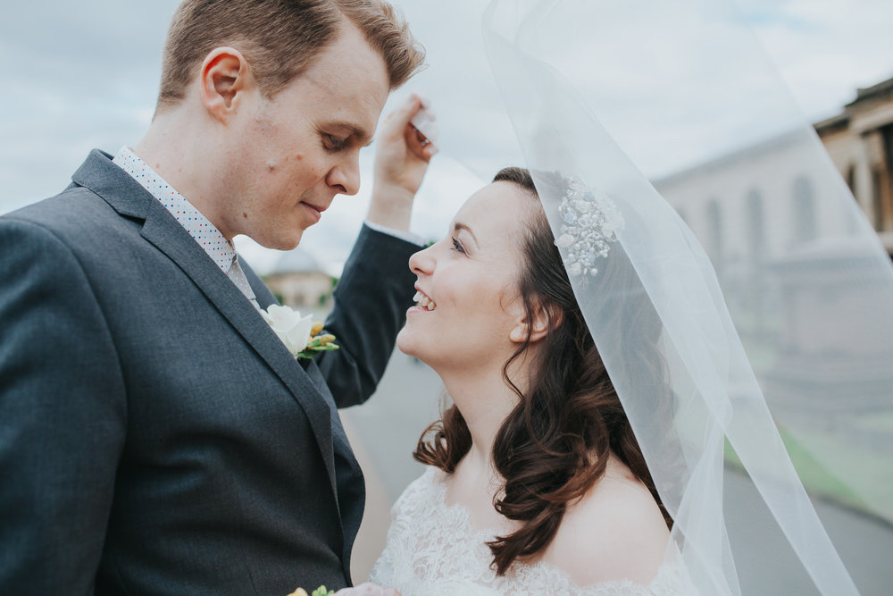 140 groom bride couple portraits windy veil Brompton Cemetery.jpg
