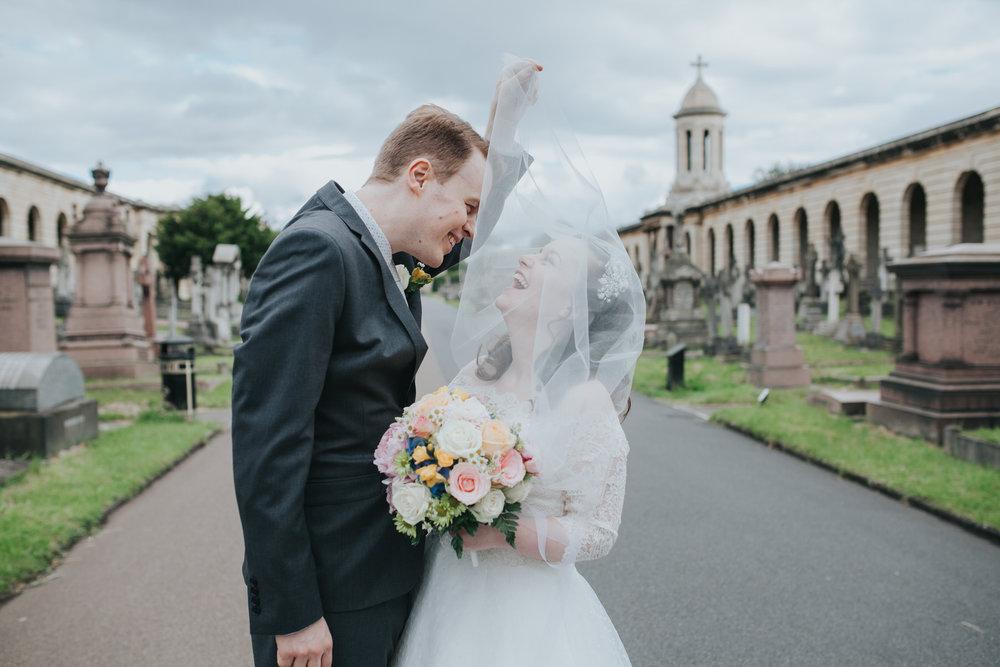 143 groom bride hillarious windy veil Brompton Cemetery.jpg