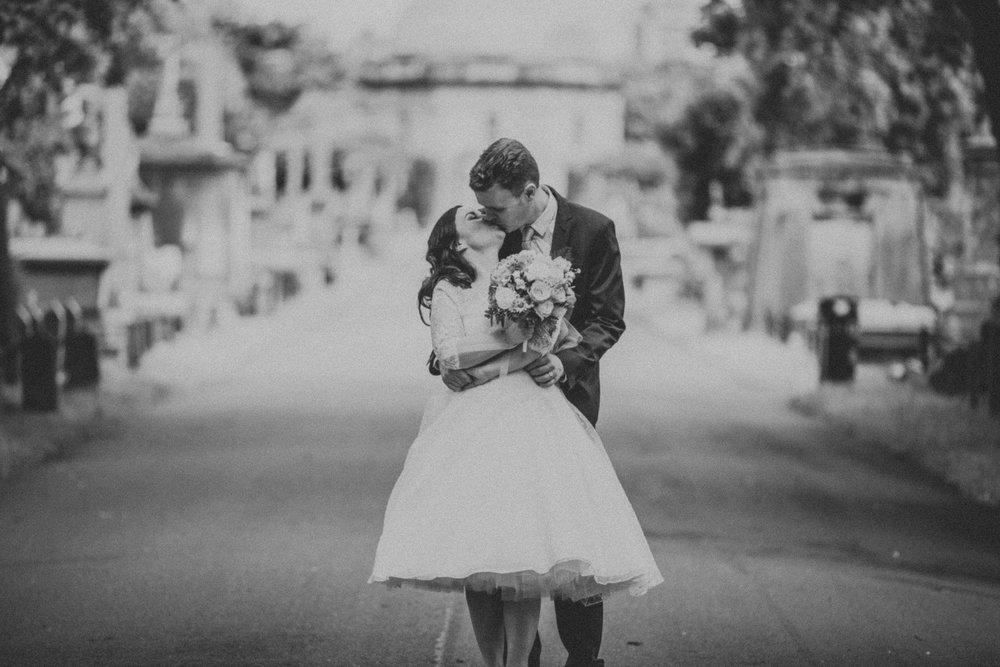 170 BW groom bride kissing wedding portraits Brompton Cemetery_.jpg