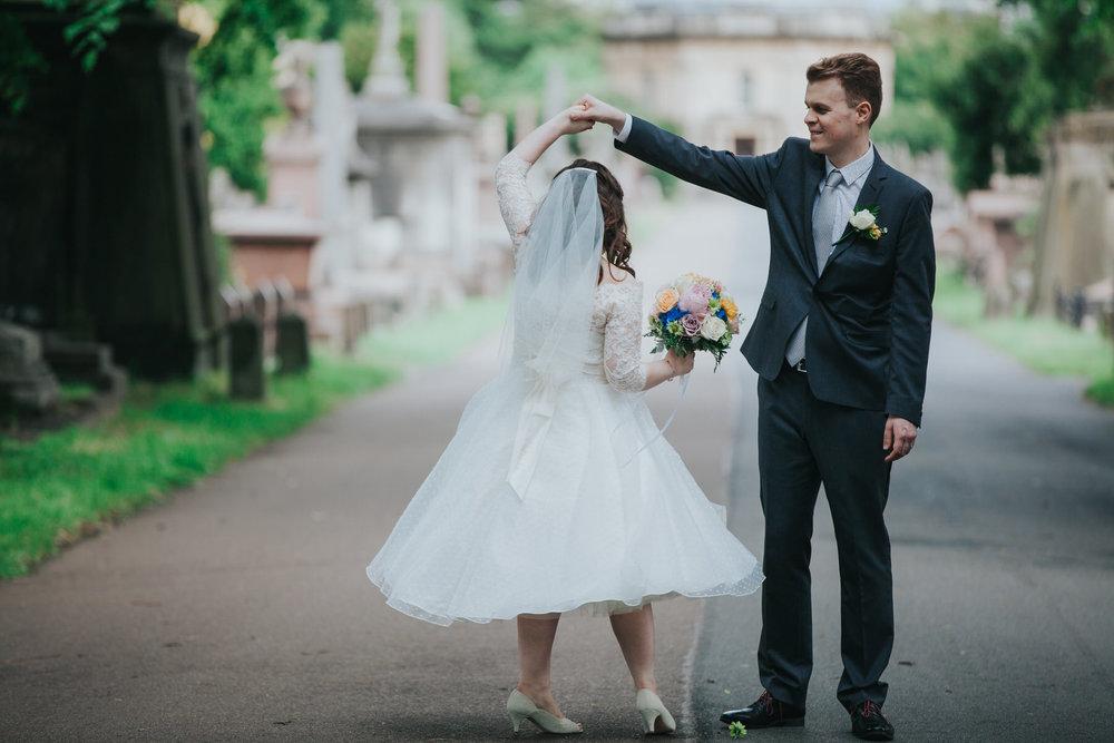 171 dancing groom bride wedding portraits Brompton Cemetery.jpg