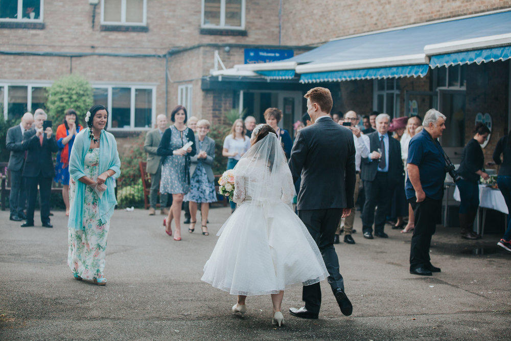 195 bride groom arrive schoolyard wedding reception.jpg