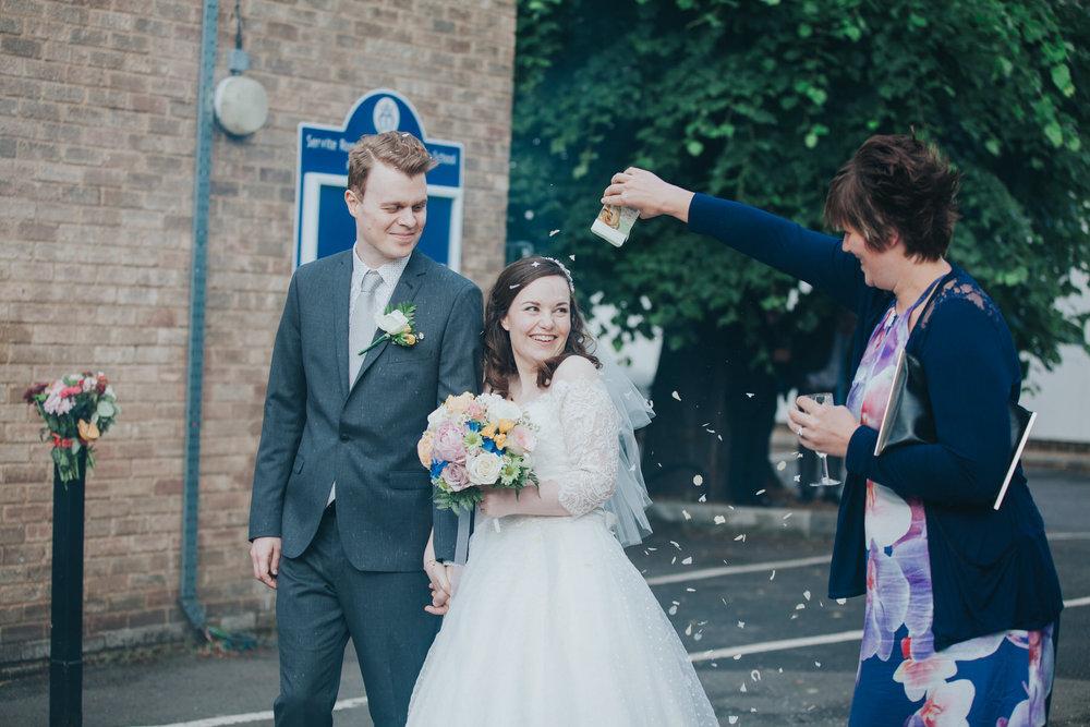 196 bride groom arrive schoolyard wedding reception confetti.jpg