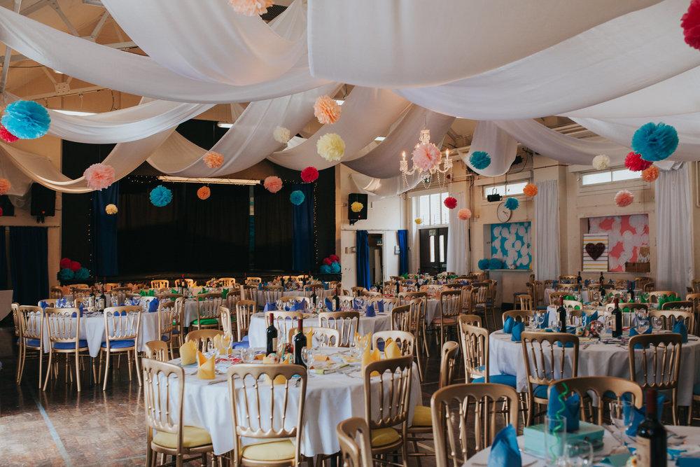 210 school hall colourful pom poms wedding reception decor.jpg