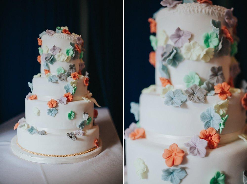 212 colourful flower covered wedding cake.jpg