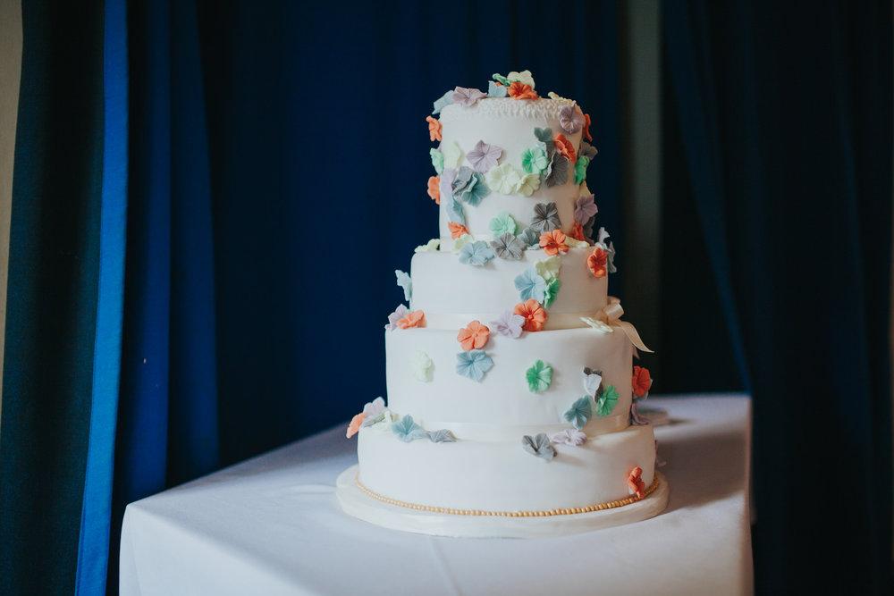 214 colourful flower covered wedding cake.jpg