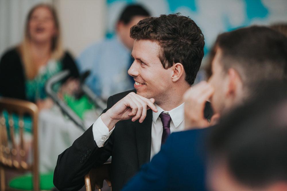 236 bestman reaction to grooms speech school hall wedding reception London.jpg