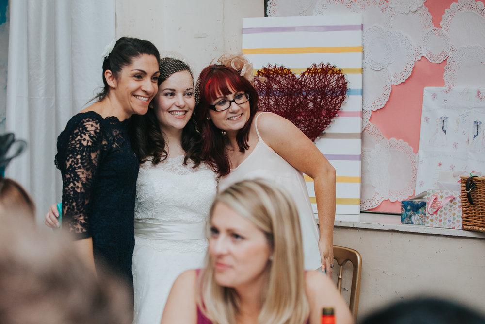 247 guests posing with bride school hall wedding.jpg